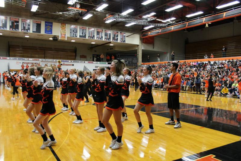 Photo by: Slicer Newsroom   The sophomore cheerleaders pump up the crowd at the pep rally.
