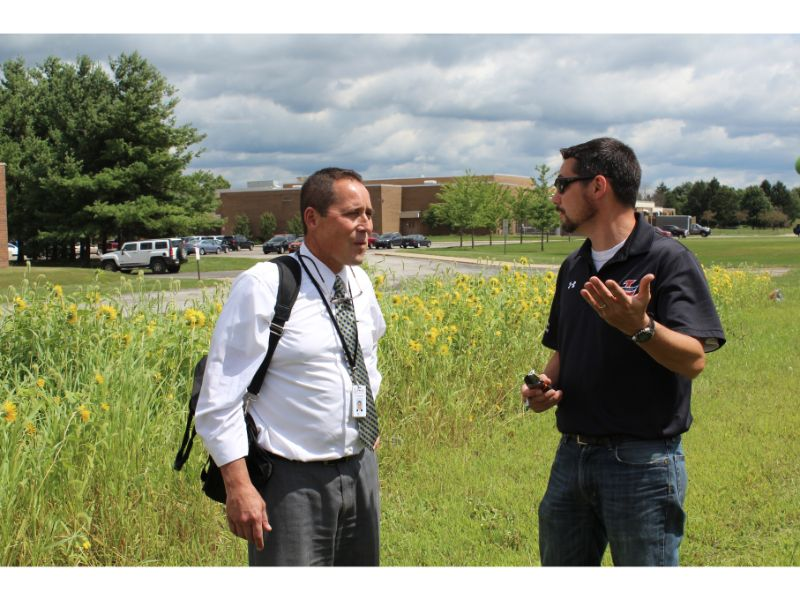 Photo+by%3A+Slicer+Newsroom+++Mr.+Walker+and+Superintendent+Francesconi+discuss+the+corn+field+outside+the+ESC+building.