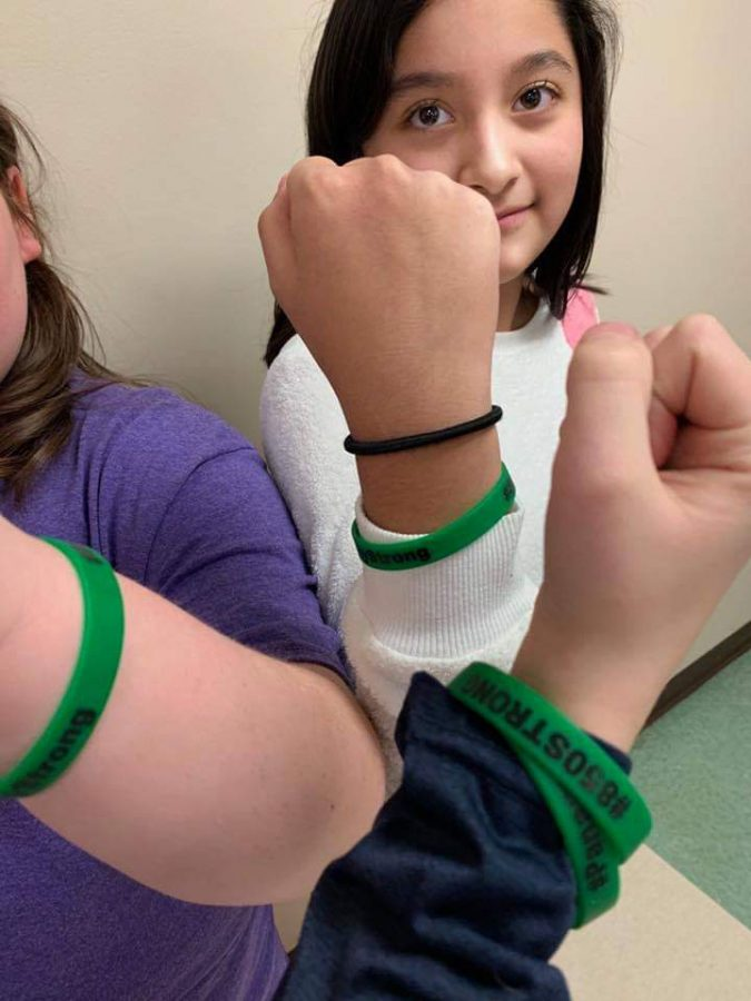 Lincoln students model their bracelets.